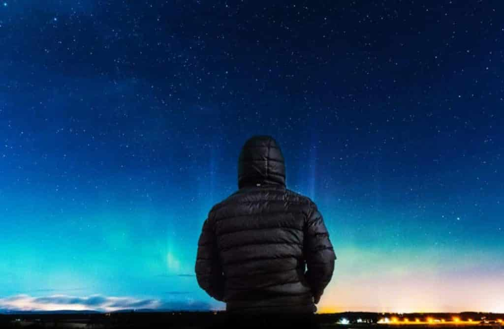 Man looking at night sky of the dreamer